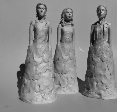 14-charmed-statues